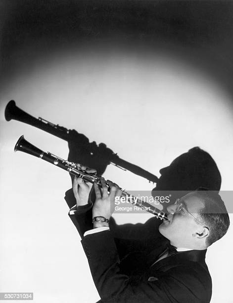 Benny Goodman poses with his clarinet This photo was taken when he performed for the NBC radio series Let's Dance in 1934