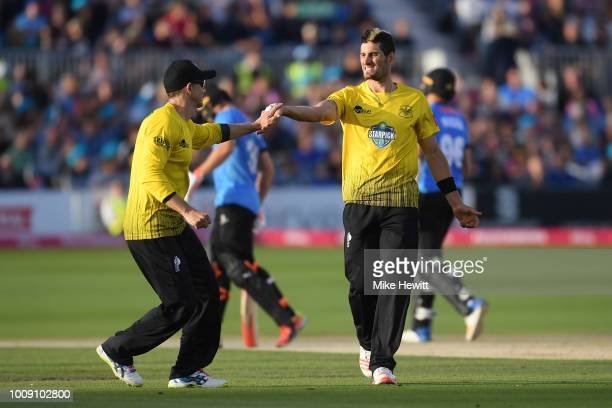 Benny Howell of Gloucestershire celebrates with Michael Klinger after dismissing David Wiese of Sussex during the Vitality Blast match between Sussex...
