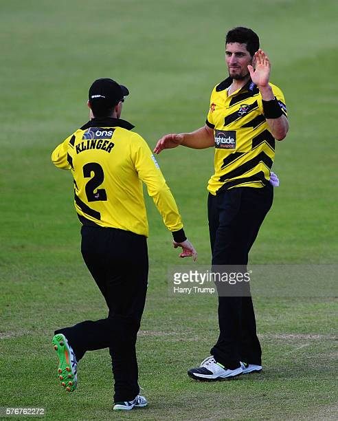 Benny Howell of Gloucestershire celebrates with Michael Klinger of Gloucestershire during the Natwest T20 Blast match between Gloucestershire and...