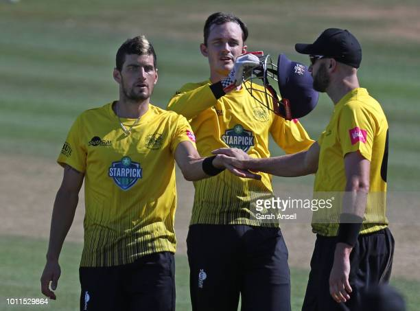 Benny Howell of Gloucestershire celebrates with teammates Gareth Roderick and Andrew Tye after taking the wicket of Heino Kuhn of Kent Spitfires...