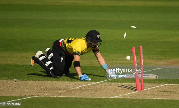 Benny Howell of Gloucestershire dives to make his ground as he survives a run out chance during the Vitality Blast match between Somerset and...
