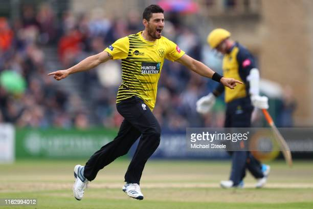 Benny Howell of Gloucesteshire celebrates capturing the wicket of Dan Douthwaite of Glamorgan during the Vitality Blast match between Gloucestershire...