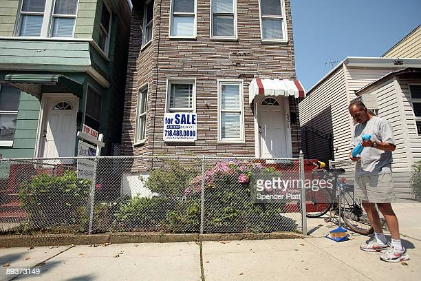 Benny Jacobellis stands in front of the home he has been trying to sell for the last eight months on July 28 2009 in the Brooklyn borough of New York...