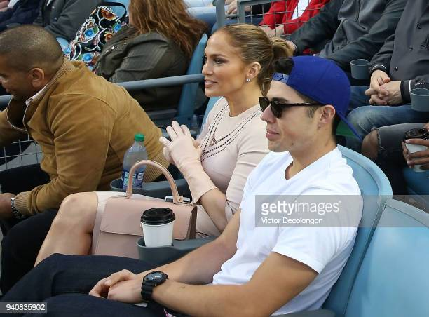 Benny Medina and Jennifer Lopez attend the MLB game between the Los Angeles Dodgers and the San Francisco Giants at Dodger Stadium on April 1 2018 in...