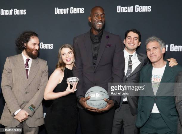 "Benny Safdie, Josh Safdie, Julia Fox, Kevin Garnett and Ronald Bronstein attend the premiere of A24's ""Uncut Gems"" at The Dome at Arclight Hollywood..."