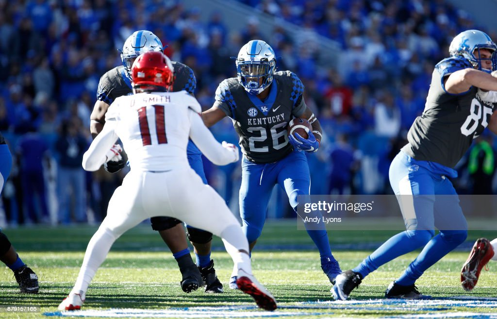 Benny Snell Jr #26 of the Kentucky Wildcats runs with the ball against the Louisville Cardinals during the game at Commonwealth Stadium on November 25, 2017 in Lexington, Kentucky.
