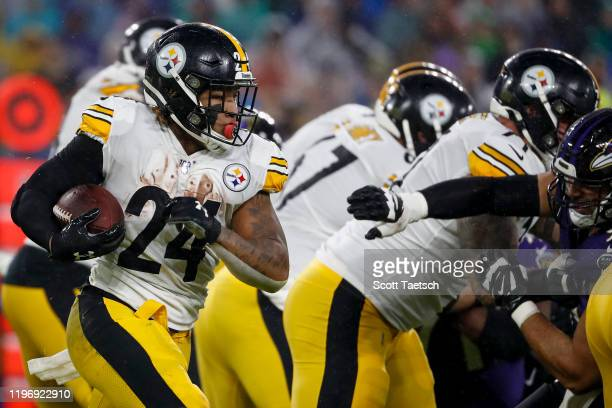Benny Snell of the Pittsburgh Steelers carries the ball against the Baltimore Ravens during the first half at M&T Bank Stadium on December 29, 2019...