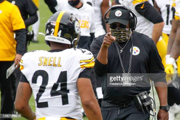Benny Snell of the Pittsburgh Steelers is congratulated by head coach Mike Tomlin after scoring a touchdown against the Tennessee Titans during the...