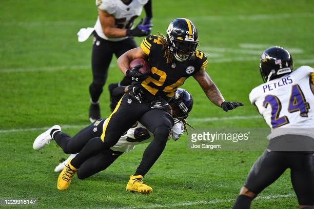 Benny Snell of the Pittsburgh Steelers is dragged down by Tramon Williams of the Baltimore Ravens during the fourth quarter at Heinz Field on...