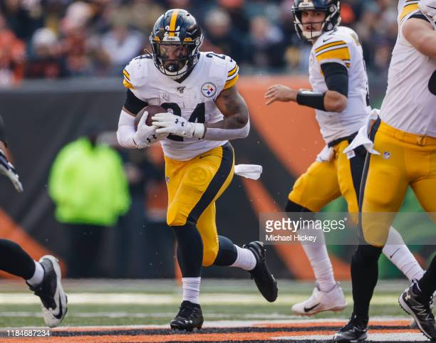 Benny Snell of the Pittsburgh Steelers runs the ball during the game against the Cincinnati Bengals at Paul Brown Stadium on November 24, 2019 in...