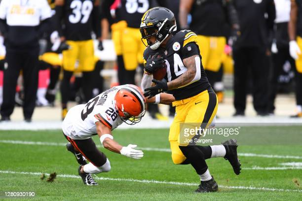 Benny Snell of the Pittsburgh Steelers rushes with the ball against Kevin Johnson of the Cleveland Browns of their NFL game at Heinz Field on October...