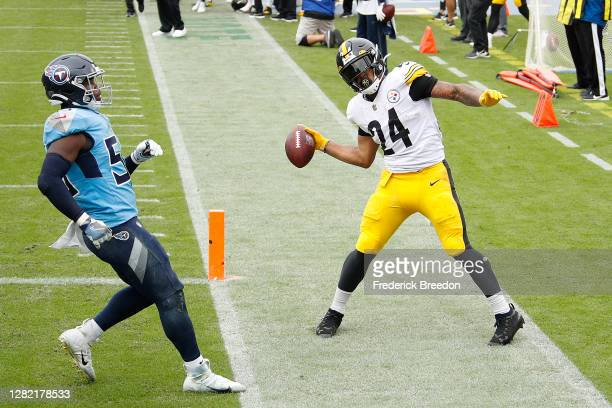 Benny Snell of the Pittsburgh Steelers spikes the ball after he scores a touchdown against the Tennessee Titans during the first half at Nissan...