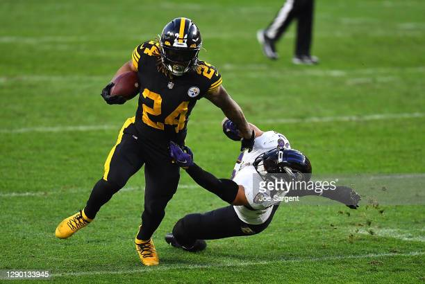 Benny Snell of the Pittsburgh Steelers stiff arms L.J. Fort of the Baltimore Ravens at Heinz Field on December 2, 2020 in Pittsburgh, Pennsylvania.
