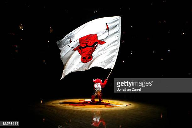 Benny the Bull mascot for the Chicago Bulls waves a giant flag with the Bulls' logo on it during pregame festivities against the New York Knicks at...