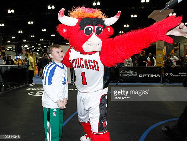 Benny the Bull, mascot of the Chicago Bulls directs a fan to the basket during a skills drill on the Kia court during Jam Session presented by Adidas...