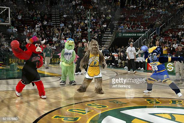Benny the Bull of the Chicago Bulls Stuff of the Orlando Magic Squatch of the Seattle Sonics and Boomer of the Indiana Pacers perform for the fans...
