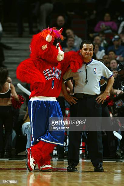 Benny the Bull the Chicago Bulls mascot shares a moment of levity with referee Tommy Nunez JR #28 during the game against the Milwaukee Bucks at...