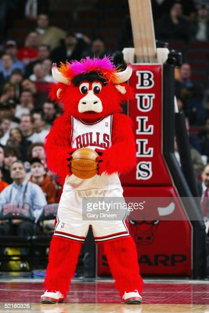 Benny the Bull the mascot of the Chicago Bulls attempts a overthehead shot during an intermission in the game against the Charlotte Bobcats on...
