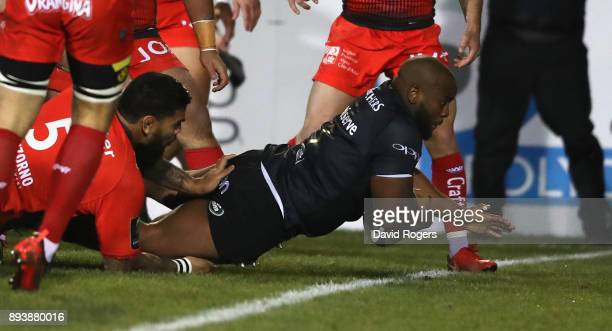 Beno Obano of Bath dives over for the firs try during the European Rugby Champions Cup match between Bath Rugby and RC Toulon at the Recreation...