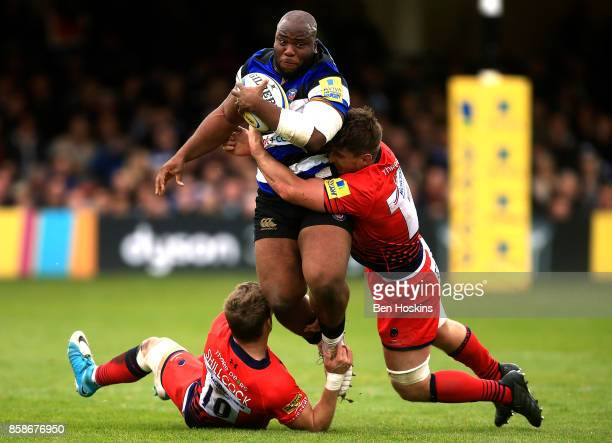 Beno Obano of Bath is tackled by Jamie Shillcock and Sam Lewis of Worcester during the Aviva Premiership match between Bath Rugby and Worcester...