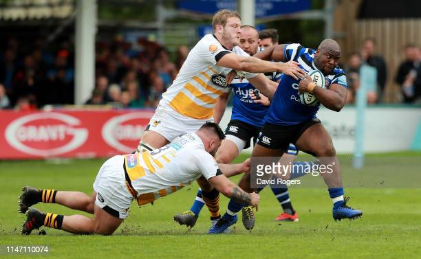 Beno Obano of Bath is tackled by Joe Launchbury and Kieran Brookes during the Gallagher Premiership Rugby match between Bath Rugby and Wasps at...