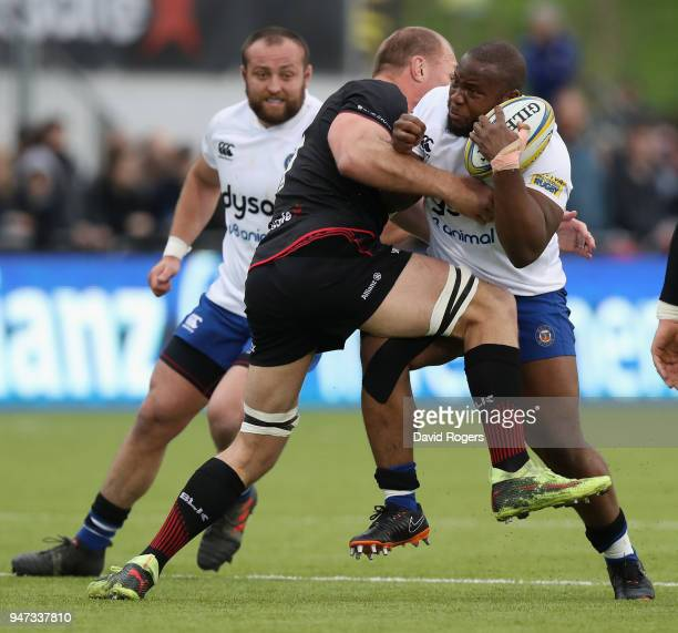 Beno Obano of Bath is tackled by Schak Burger during the Aviva Premiership match between Saracens and Bath Rugby at Allianz Park on April 15 2018 in...