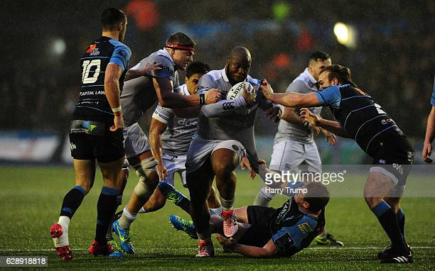 Beno Obano of Bath Rugby is tackled by Rhys Gill of Cardiff Blues during the European Rugby Challenge Cup match between Cardiff Blues and Bath Rugby...