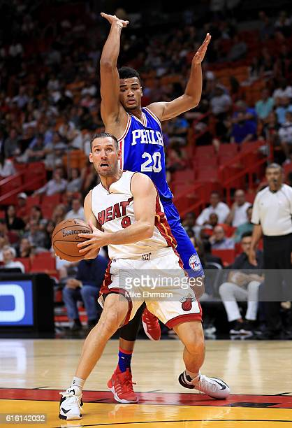 Beno Udrih of the Miami Heat drives on Timothe LuwawuCabarrot of the Philadelphia 76ers during a preseason game at American Airlines Arena on October...