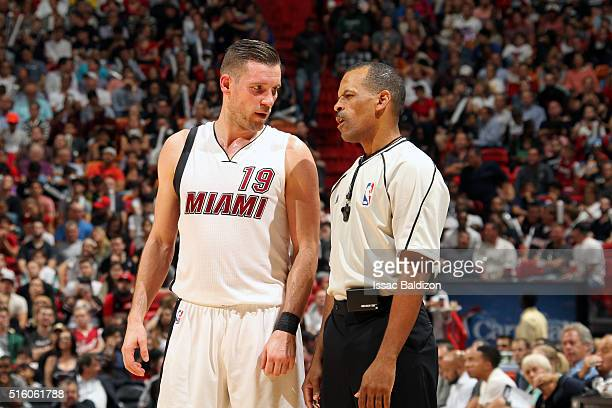 Beno Udrih of the Miami Heat talks with NBA referee Eric Lewis during the game against the Detroit Pistons on December 22 2015 at American Airlines...