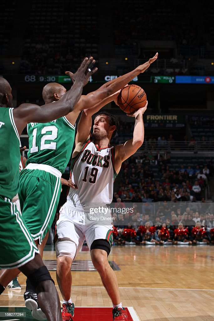 Beno Udrih #19 of the Milwaukee Bucks drives to the basket against Leandro Barbosa #12 of the Boston Celtics on November 10, 2012 at the BMO Harris Bradley Center in Milwaukee, Wisconsin.