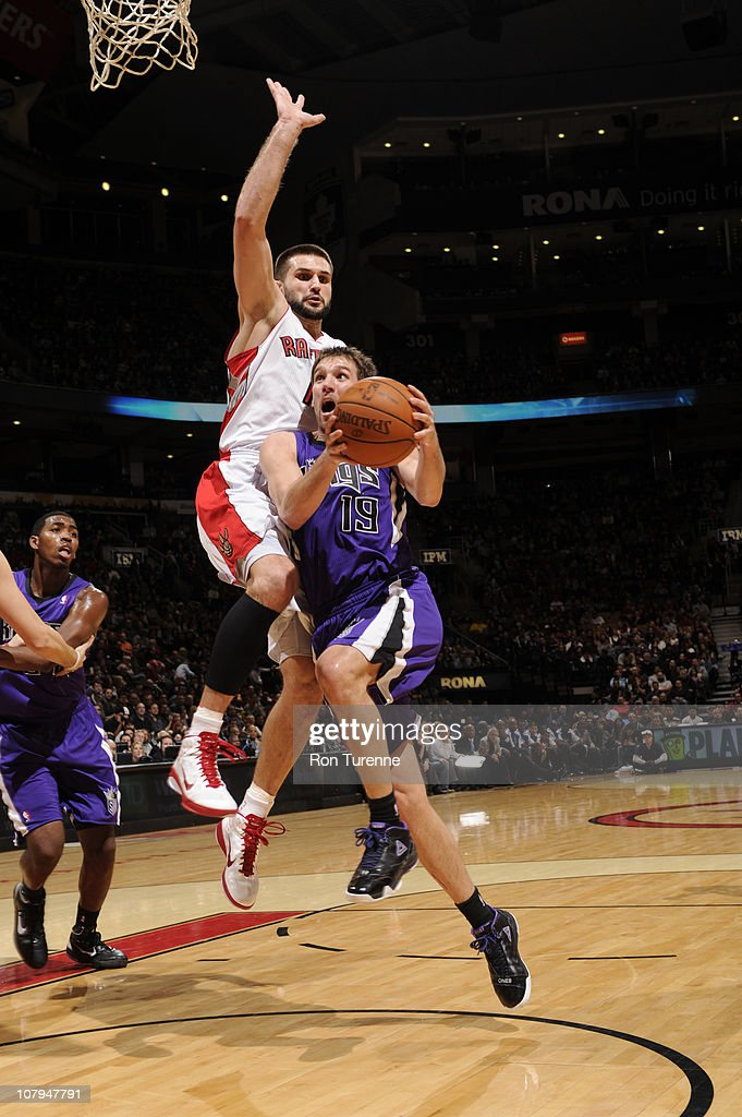 Beno Udrih #19 of the Sacramento Kings drives against Linas Kleiza #11of the Toronto Raptors during a game on January 9, 2011 at the Air Canada Centre in Toronto, Ontario, Canada.