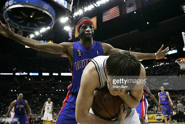 Beno Udrih of the San Antonio Spurs holds his mouth after getting hit by Richard Hamilton of the Detroit Pistons in the fourth quarter in Game two of...