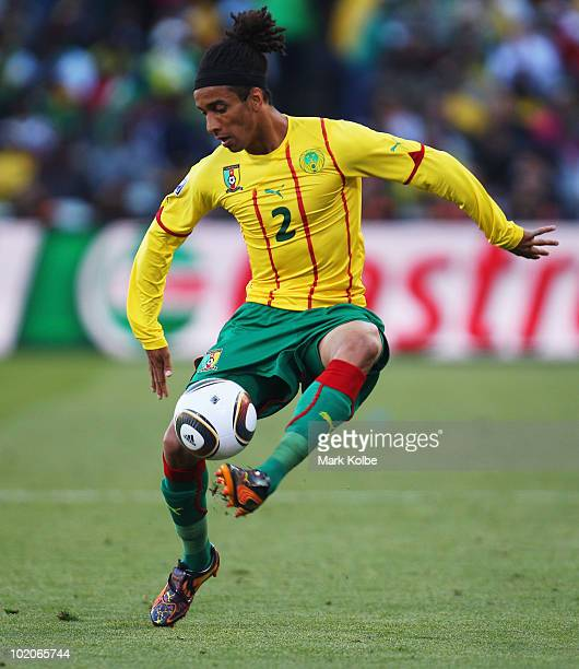 Benoit Assou Ekotto of Cameroon controls the ball during the 2010 FIFA World Cup South Africa Group E match between Japan and Cameroon at the Free...