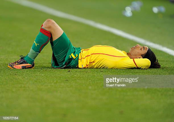 Benoit Assou Ekotto of Cameroon is dejected after defeat in the 2010 FIFA World Cup South Africa Group E match between Japan and Cameroon at the Free...