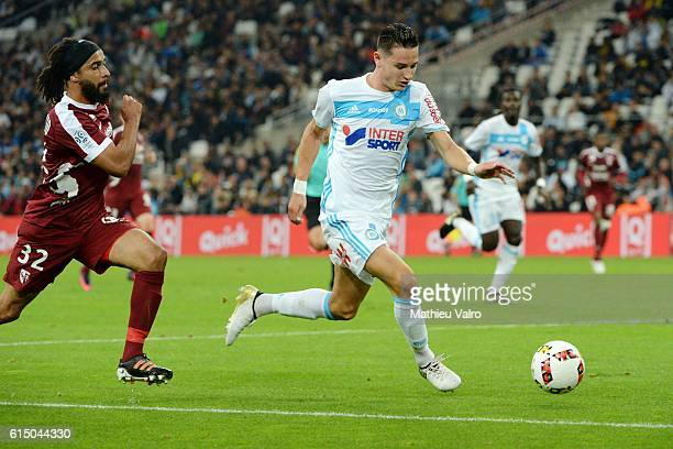 Benoit ASSOU EKOTTO of Metz and Florian THAUVIN of Marseille during the Ligue 1 match between Olympique de Marseille and FC Metz at Stade Velodrome...
