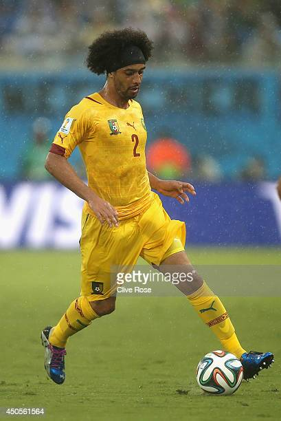 Benoit AssouEkotto of Cameroon controls the ball during the 2014 FIFA World Cup Brazil Group A match between Mexico and Cameroon at Estadio das Dunas...