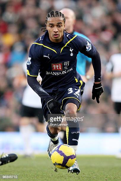 Benoit AssouEkotto of Spurs runs with the ball during the Barclays Premier League match between Fulham and Tottenham Hotspur at Craven Cottage on...