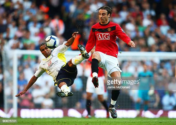 Benoit AssouEkotto of Tottenham and Dimitar Berbatov of Manchester United battle for the ball during the Barclays Premier League match between...