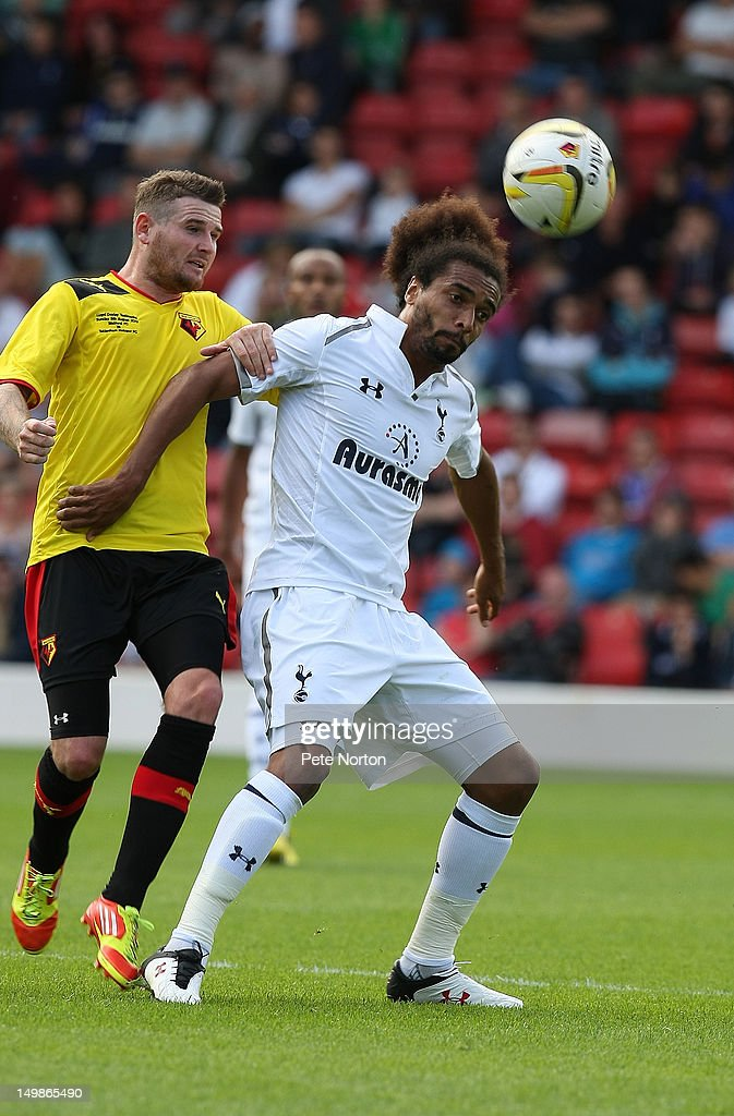 Benoit Assou-Ekotto of Tottenham Hotspur attempts to control the ball under pressure from Mark Yeates of Watford during the pre-season friendly match between Watford and Tottenham Hotspur at Vicarage Road on August 5, 2012 in Watford, United Kingdom.