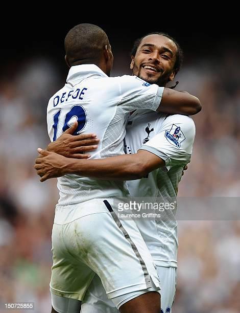 Benoit AssouEkotto of Tottenham Hotspur celebrates his goal with Jermain Defoe during the Barclays Premier League match between Tottenham Hotspur and...
