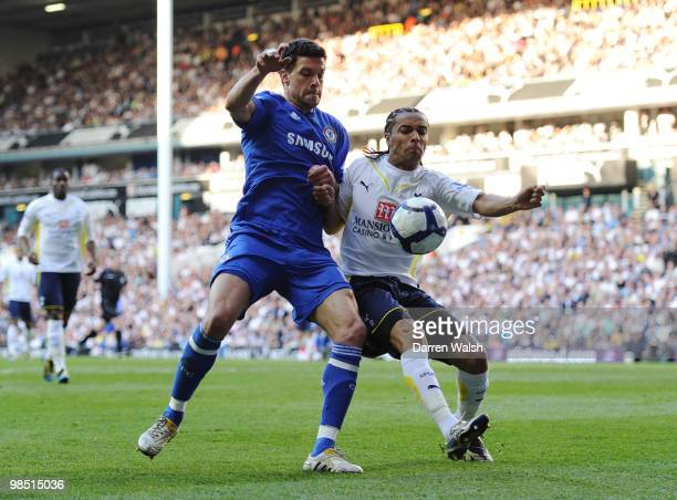 Benoit AssouEkotto of Tottenham Hotspur challenges Michael Ballack of Chelsea during the Barclays Premier League match between Tottenham Hotspur and...