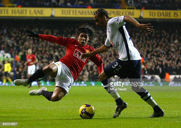Benoit Assou-Ekotto of Tottenham Hotspur is challenged by Carlos Tevez of Manchester United during the Barclays Premier League match between...