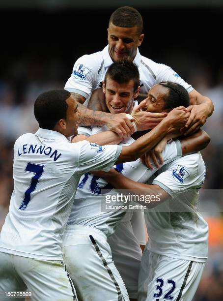 Benoit AssouEkotto of Tottenham Hotspur is mobbed by team mates after his goal during the Barclays Premier League match between Tottenham Hotspur and...