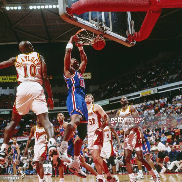 Benoit Benjamin of the New Jersey Nets dunks against the Atlanta Hawks during a game played circa 1990 at the Omni in Atlanta Georgia NOTE TO USER...