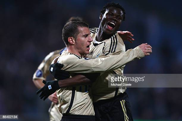 Benoit Cheyrou celebrates scoring the first goal with Ismaila Taiwo Taye during the Uefa Cup last sixteen first leg match between Olympique Marseille...
