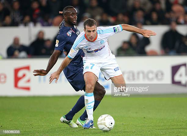 Benoit Cheyrou of Olympique de Marseille and Mohamed Sissoko of Paris Saint Germain in action during the french eightfinals League Cup match between...
