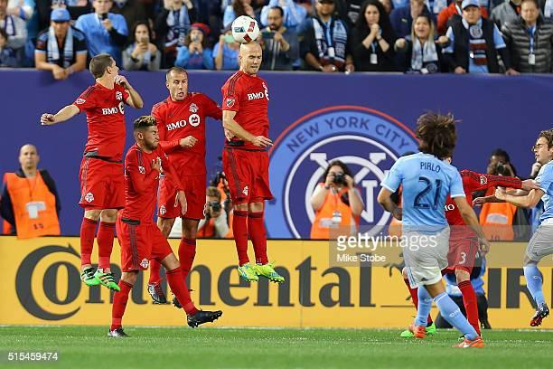 Benoit Cheyrou of Toronto FC defends Andrea Pirlo of New York City FC free kick at Yankee Stadium on March 13 2016 in the Bronx borough of New York...