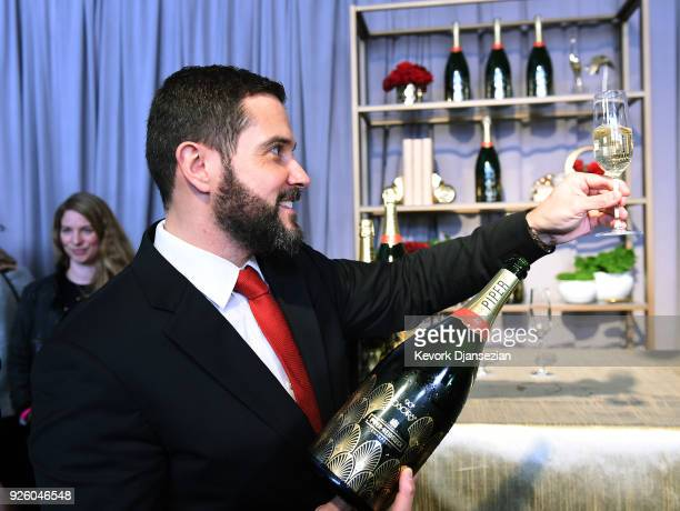 Benoit Collard, of Piper-Heidsieck, pours a glass of champagne during the 90th Annual Academy Awards Governors Ball on March 1, 2018 in Hollywood,...