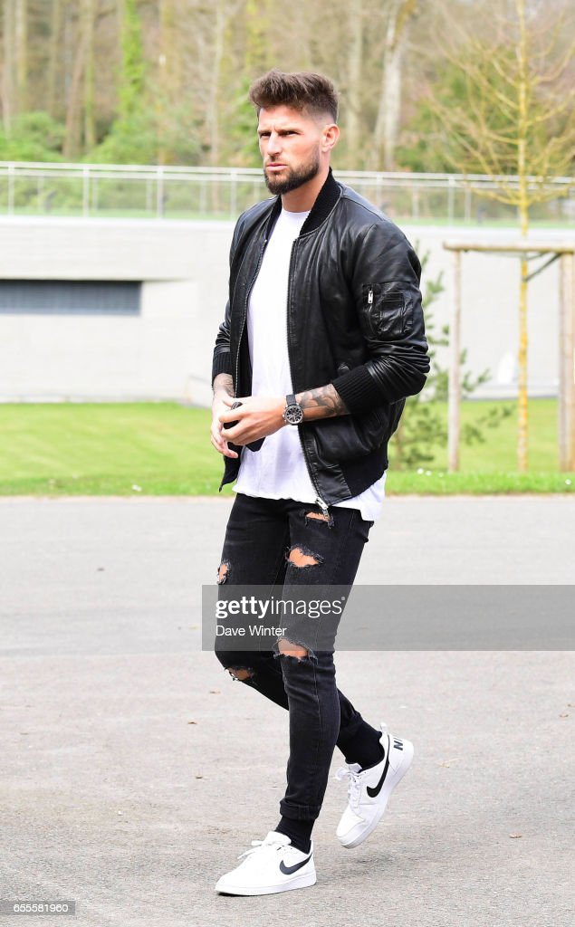 Benoit Costil and Corentin Tolisso of France arriving at Centre National du Football on March 20, 2017 in Clairefontaine, France.