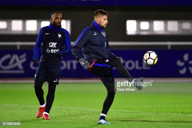 Benoit Costil of France and Alexandre Lacazette of France during the training session at the Centre National de Football in Clairefontaine en...